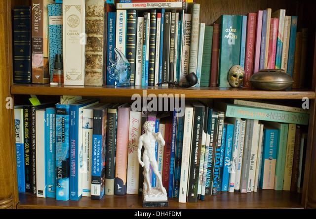 Close up of books on a bookshelf. - Stock Image