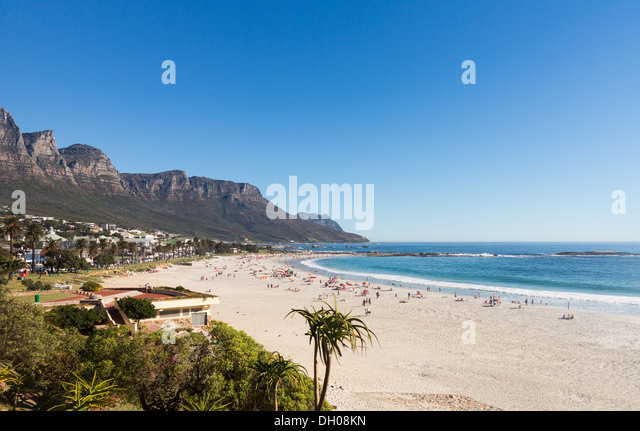 Beach at Camps Bay, Cape Town, South Africa with Table Mountain in background - Stock Image