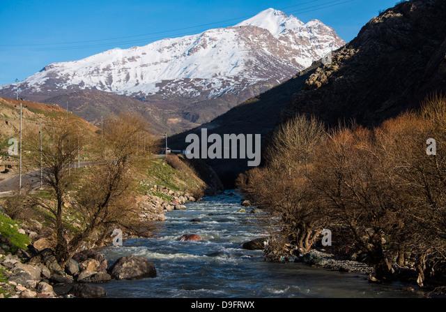 Snow capped mountains above the great Zab River along the Hamilton road leading into Iran, Iraq Kurdistan, Iraq, - Stock Image