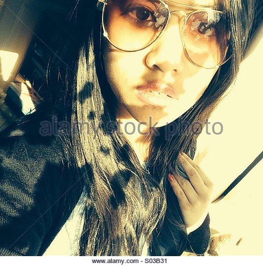 Sunglasses and shadows - Stock-Bilder