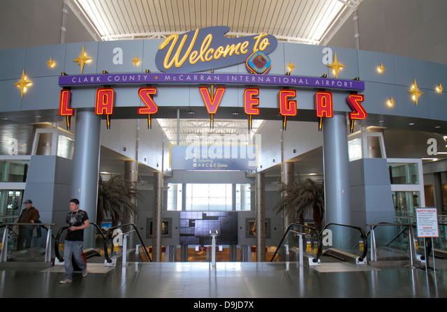 Nevada Las Vegas McCarran International Airport LAS terminal concourse gate area welcome sign - Stock Image