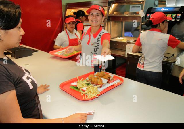 Lima Peru Jiron de la Union historic district peatonal promenade pedestrian mall shopping dining KFC Kentucky Fried - Stock Image
