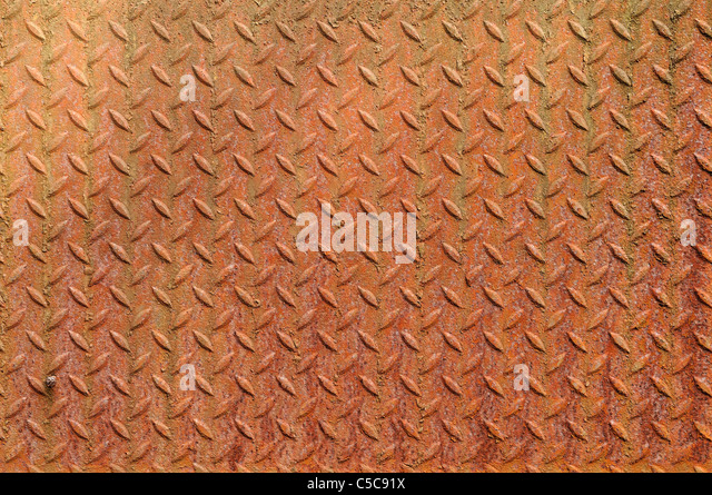 Texture of a grunge metal diamond plate. - Stock Image