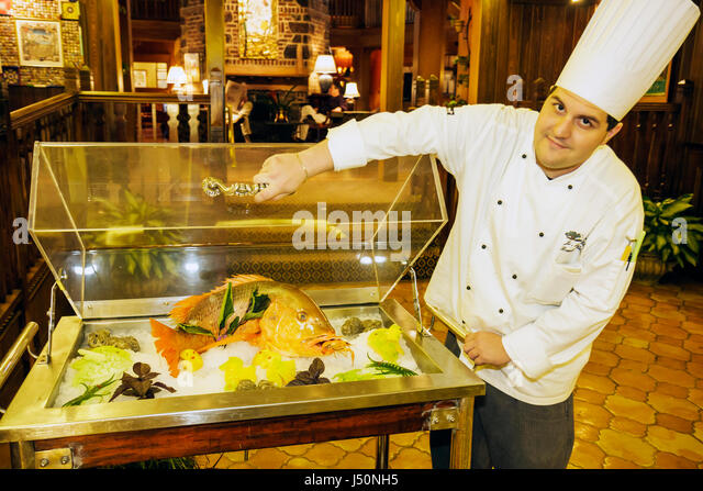 Point Clear Alabama Grand Hotel Marriott Resort hotel lodging lobby red snapper man chef fish food display - Stock Image