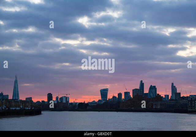 London skyline at sunset with apartment blocks - Stock Image