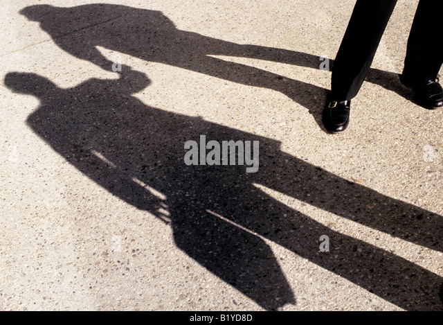 Shadows of Two Businessmen Shaking Hands Shadows New York City USA - Stock Image
