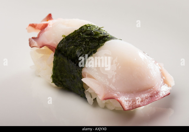 tako octopus fresh seafood pink white seaweed rice rapped appetizer meal Asian consumption eat food - Stock Image