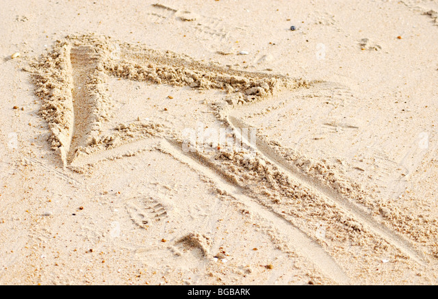 Photograph of up arrow sand forward direction profit success UK - Stock-Bilder