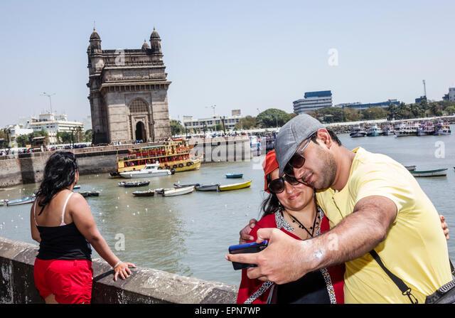 Mumbai India Asian Apollo Bandar Colaba PJ Ramchandani Marg woman man couple taking selfie picture camera Gateway - Stock Image