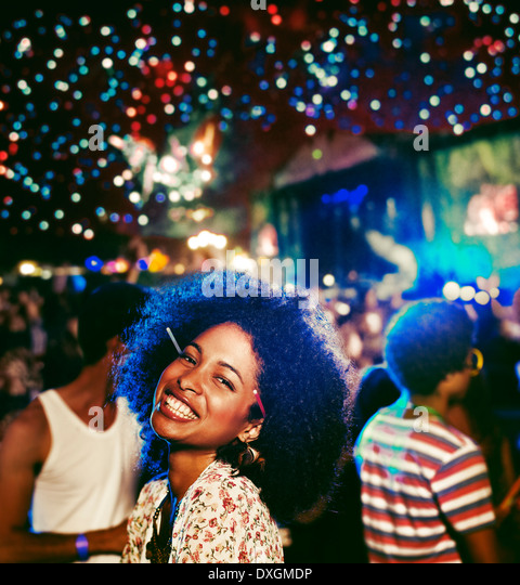 Portrait of enthusiastic woman at music festival - Stock-Bilder