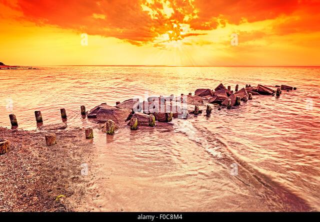 Beautiful amber sunset over beach, summer background. - Stock Image