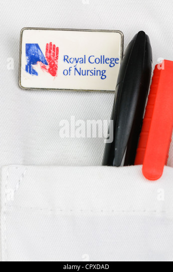 Closeup of a Royal College of Nursing badge on a nurses uniform - Stock Image