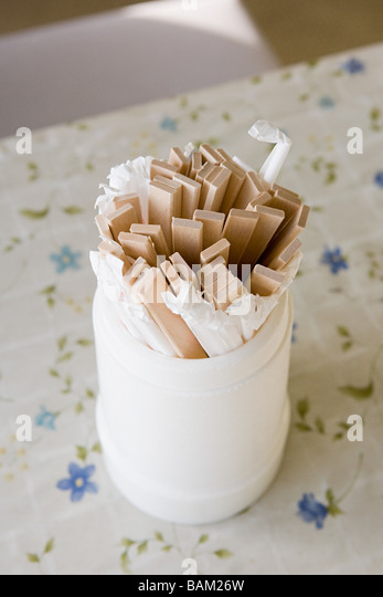 A container of wooden chopsticks - Stock Image