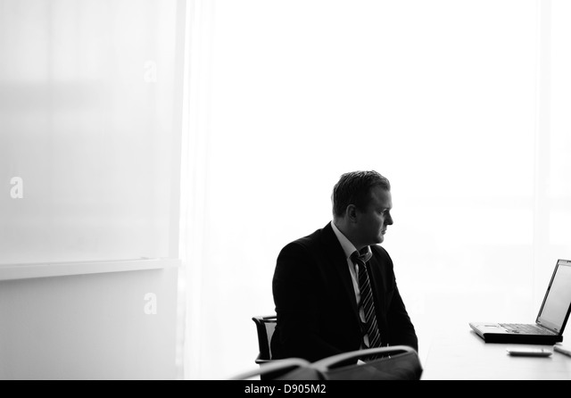 Businessman looking at laptop - Stock Image