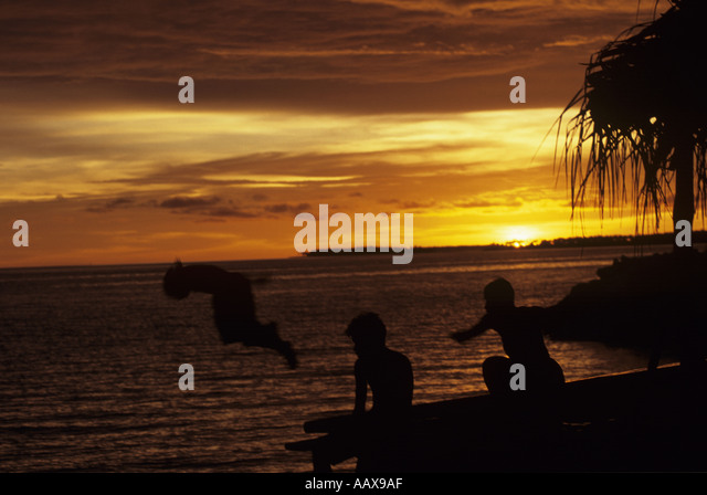 Kids playing sunset in the Marshall Islands - Stock Image