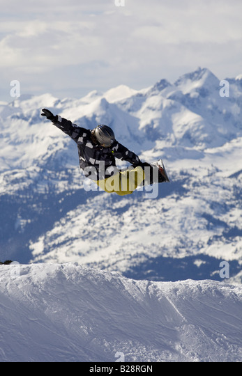 Snowboarders enjoying the snowboard park Whistler British Columbia Canada - Stock Image
