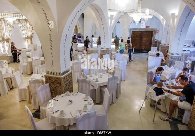 Spain Europe Spanish Hispanic Toledo Carlos V hotel inside interior breakfast room restaurant tables - Stock Image