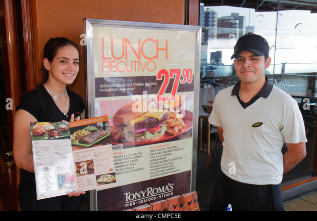 Lima Peru Miraflores Malecon de la Reserva Lancomar shopping center centre dining Tony Roma's restaurant international - Stock Image