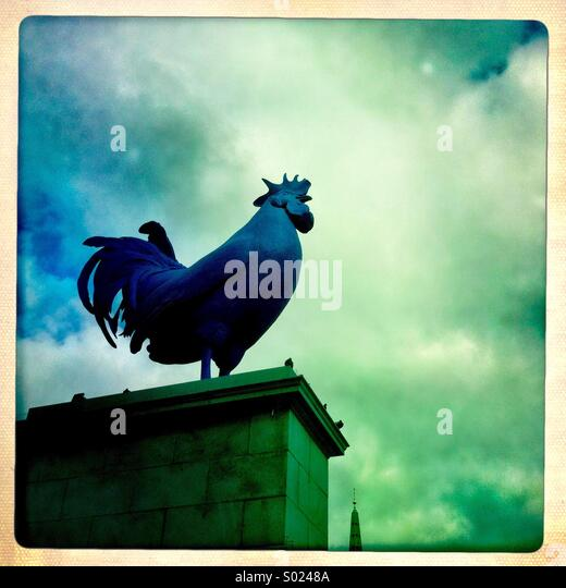 The purple chicken. Art piece in Trafalgar square. London England UK. - Stock Image