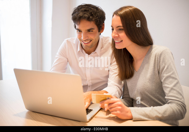 Woman man computer shopping online home - Stock Image
