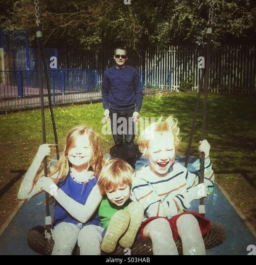 Children on a Swing - Stock Image