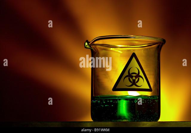 Liquid filled laboratory beaker with biohazard symbol - Stock Image