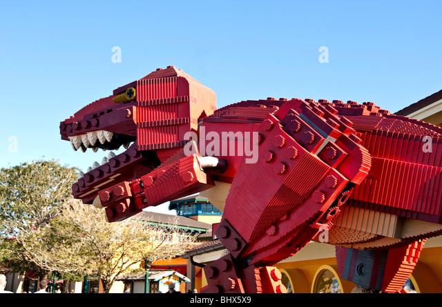 Red Lego dinosaur sculpture outdoors Downtown Disney  Marketplace Orlando Florida FL - Stock Image