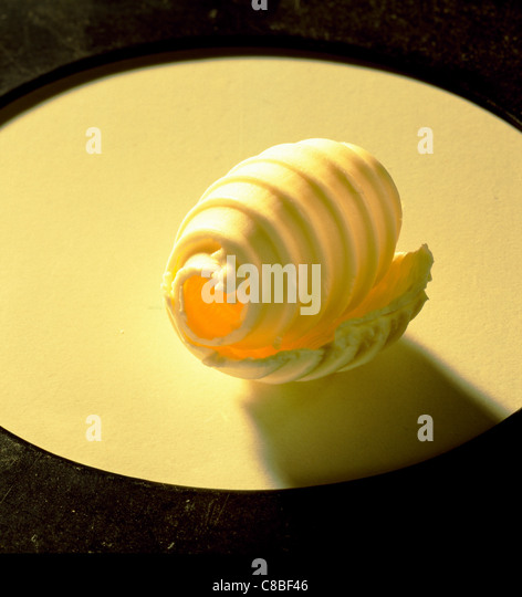 curl of butter - Stock Image