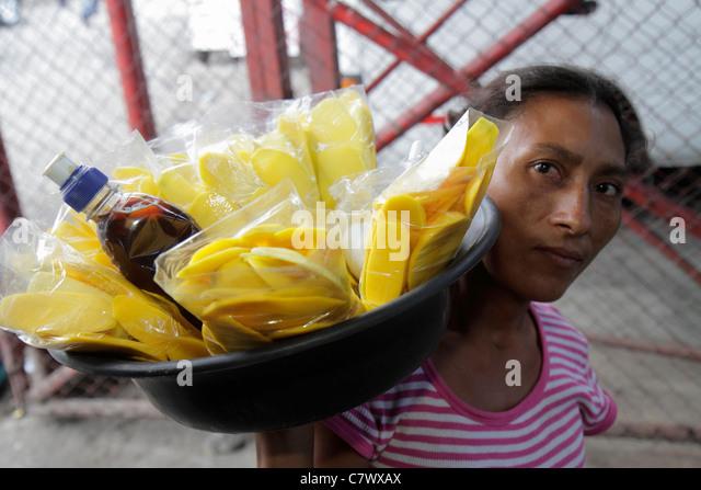Managua Nicaragua Latin America Pista Juan Pablo II street food vendor informal economy Hispanic woman indigenous - Stock Image