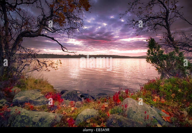 View of lake at dusk - Stock Image