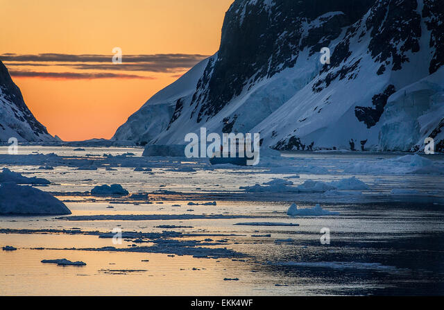 Tourist icebreaker in the dramatic scenery of the Lemaire Channel on the Antarctic Peninsula in Antarctica. - Stock Image