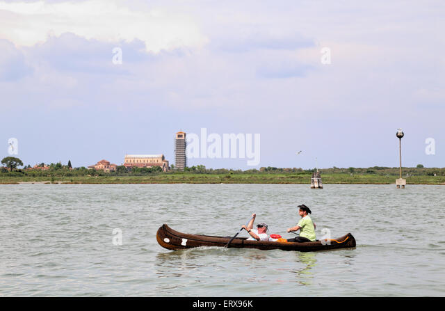 Canoeing in the Venetian Lagoon, Laguna Veneta, in front of Torcello Island - Stock Image
