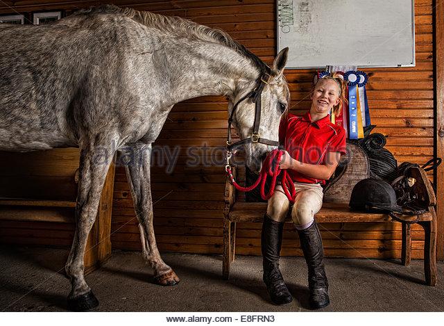 USA, Colorado, Douglas County, Horse nuzzling girl - Stock Image