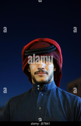 Portrait of a young Jordanian Bedouin man wearing a traditional Keffiyeh. - Stock Image