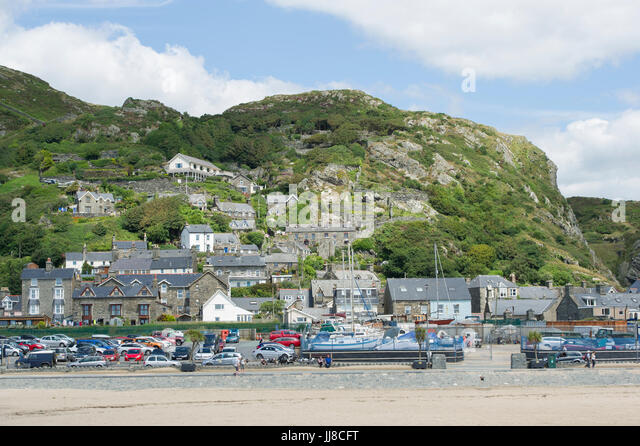 A view of the town and beach at the seaside town of Barmouth in Wales - Stock Image