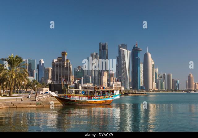 Al Bidda Burj Doha Qatar Middle East World Trade Center architecture bay boat city colourful corniche futuristic - Stock Image