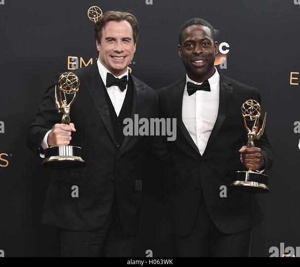 LOS ANGELES, CA - SEPTEMBER 18:  John Travolta and Sterling K. Brown in the press room at the 68th Emmy Awards at - Stock-Bilder