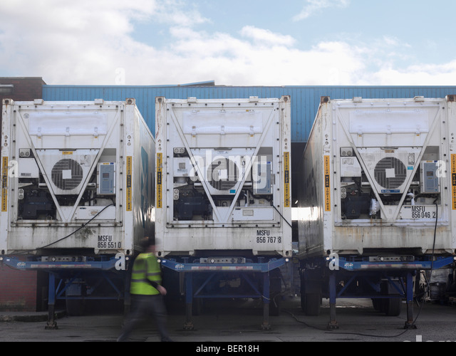 Refrigerated Lorries At Food Factory - Stock Image