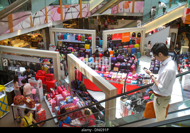 Hong Kong China Kowloon Tsim Sha Tsui Sogo Department Store escalator overhead view shopping Asian man checking - Stock Image