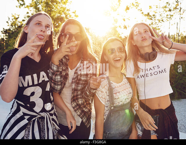 Group of teenagers having fun outside in a park - Stock-Bilder