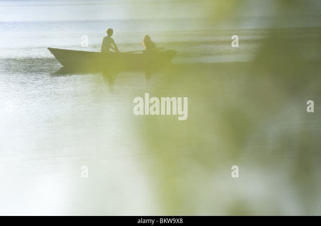 People in a boat - Stock Image