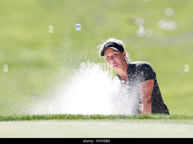 April 02, 2017 Suzann Petterson of Norway hits out of a bunker on the eighth hole during the final round of the - Stock-Bilder