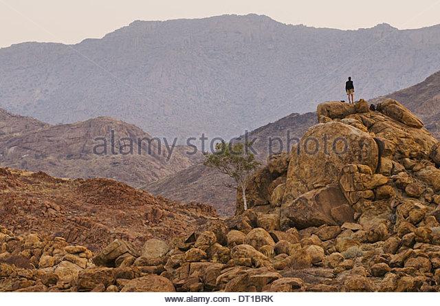 Tsiseb Conservancy Damaraland Namibia person standing overlooking Brandberg Tsiseb - Stock Image