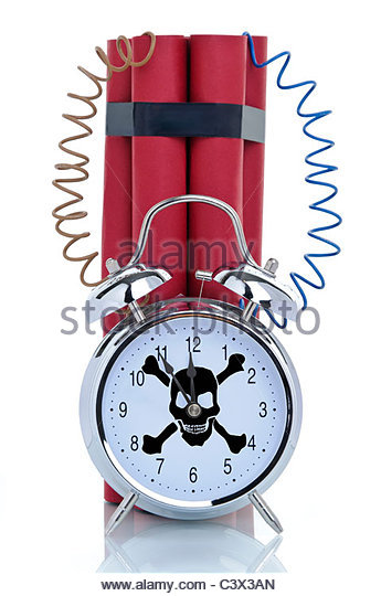 Time bomb, alarm clock with skull and dynamite sticks, symbolic image - Stock Image