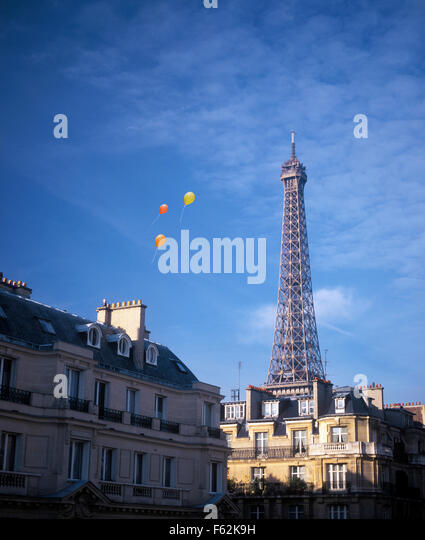 France, Paris, Balloons Floating By Eiffel Tower - Stock Image