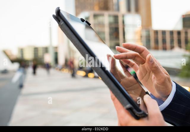 Female Digital Tablet hand outdoor Building - Stock Image