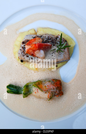 Grilled tuna steak and shrimp on mashed potatoes, Restaurant Ricasso, Munich, Upper Bavaria, Bavaria, Germany, Europe - Stock Image