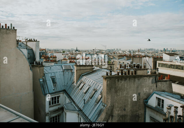 Panorama of Paris with many rooftops - Stock Image