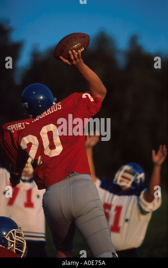 American Football young men playing football - Stock Image