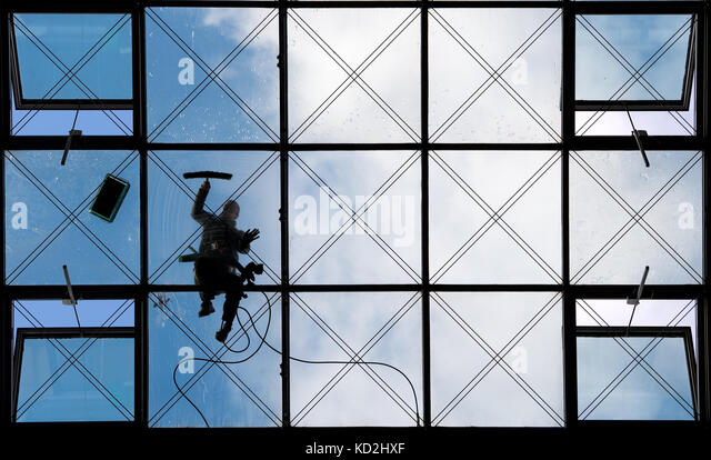 Dresden, Germany. 9th Oct, 2017. Glass and buildings cleaner Andreas Reimann cleaning the glass panes of the roof - Stock Image